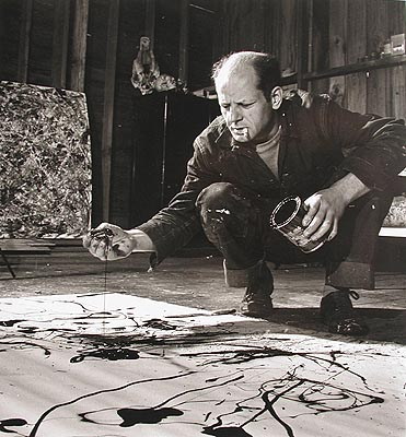Jackson Pollock painting in his studio, Springs, New York, 1949 © Time Inc